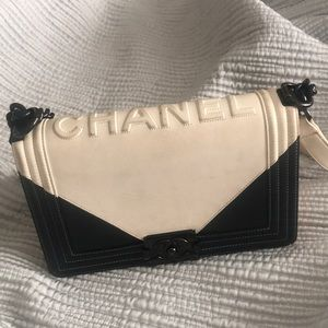 White and black Chanel bag